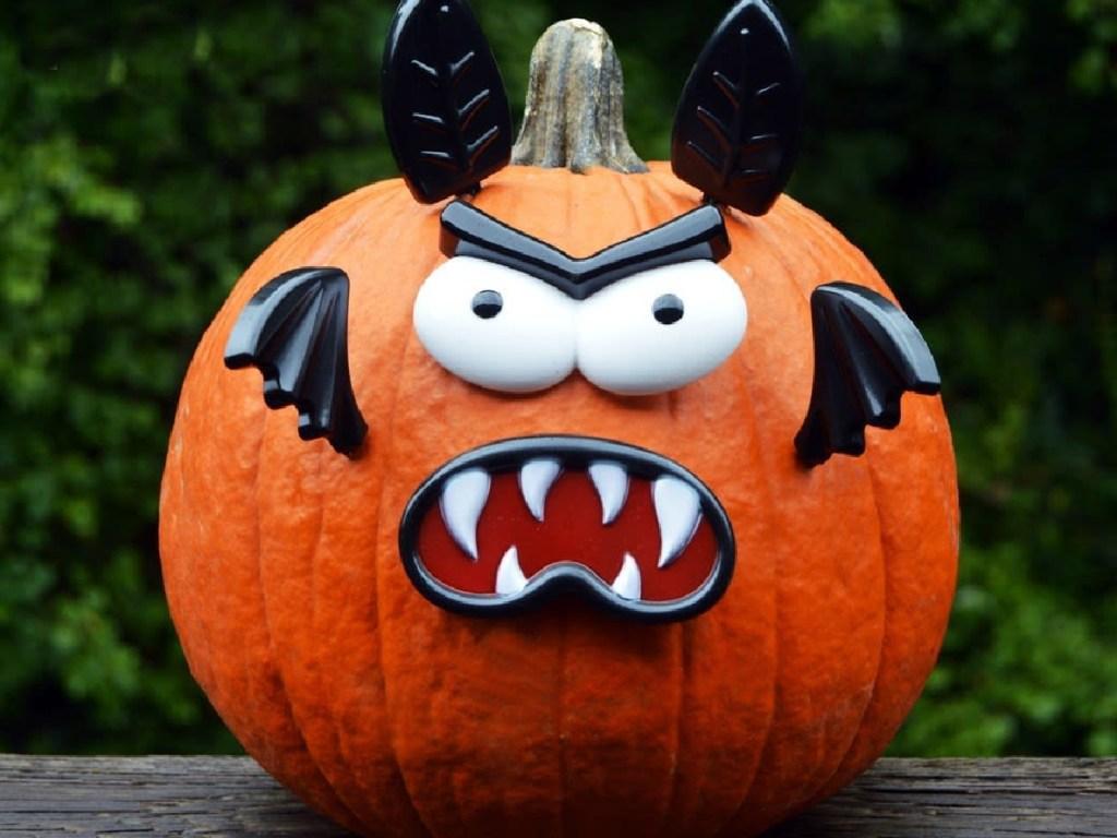 Bat no carve pumpkin decorating kit on a large round pumpkin