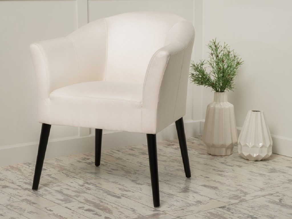 light grey and black fabric arm chair next to vases on floor