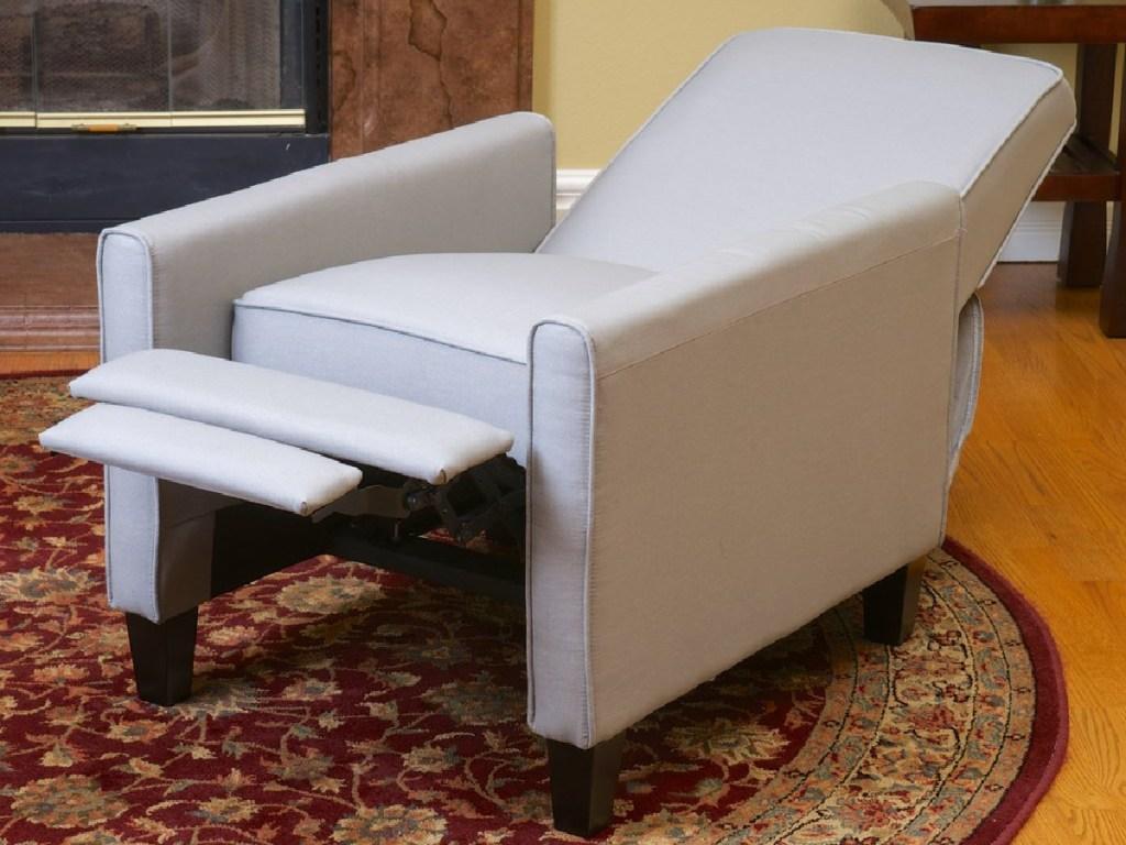 gray recliner on carpet in living room