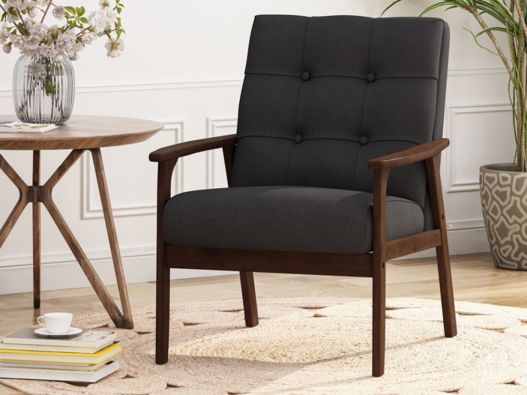 black club chair next to side table in home