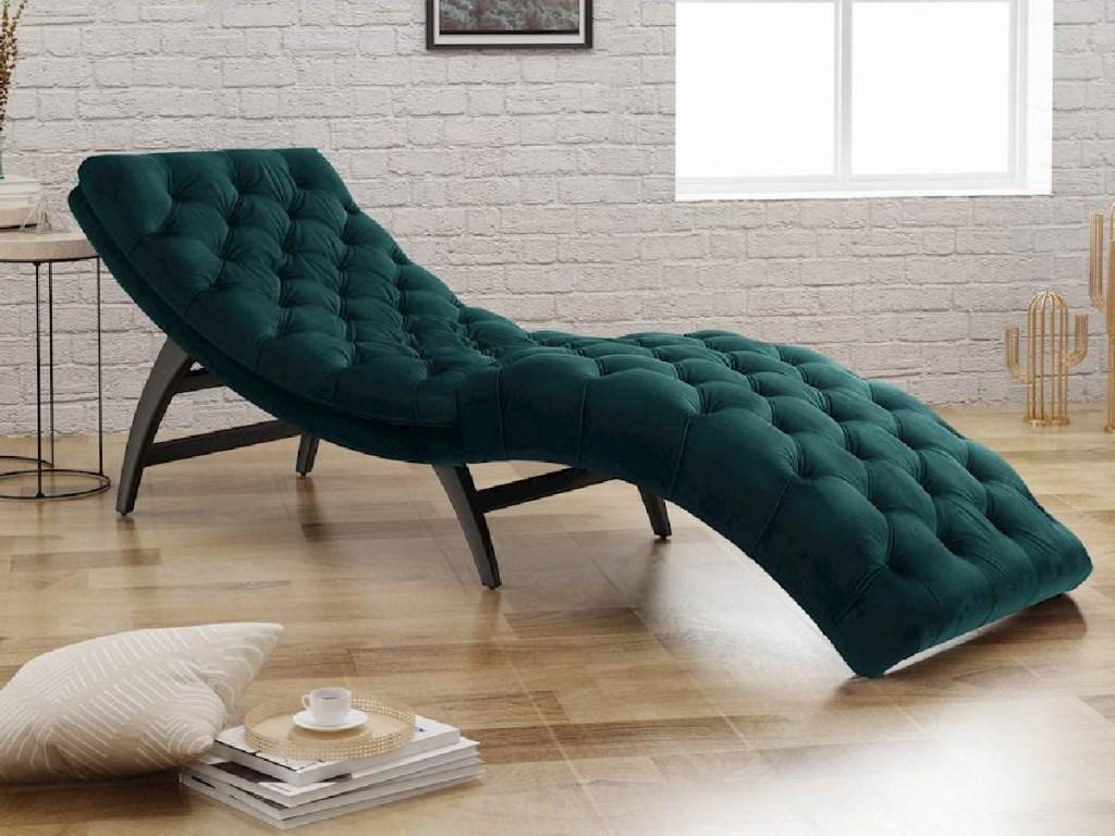 green velvet chaise lounge in home