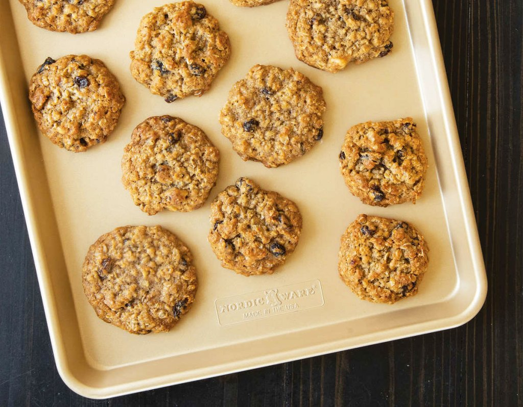 gold nordic ware baking sheet with oatmeal cookies on it
