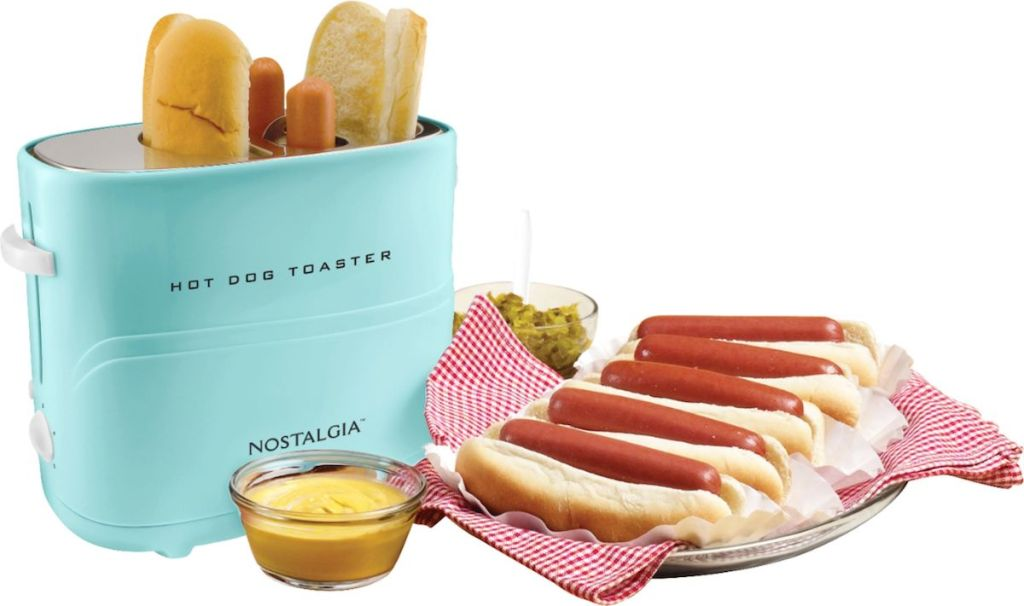 Nostalgia Hot Dog toaster next to plate of hot dogs