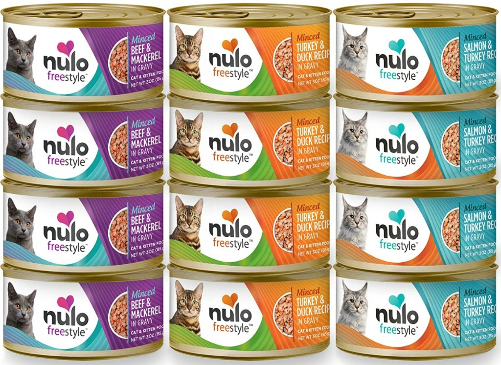 Large stack of cat food cans in a variety of flavors