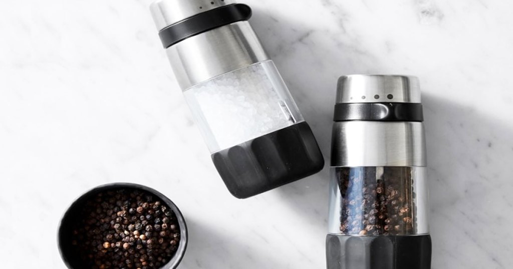 salt and pepper grinder set on a marble countertop