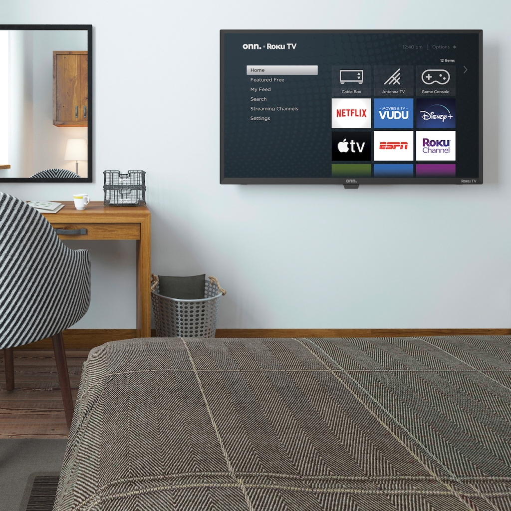 Onn Roku TV hanging on bedroom wall