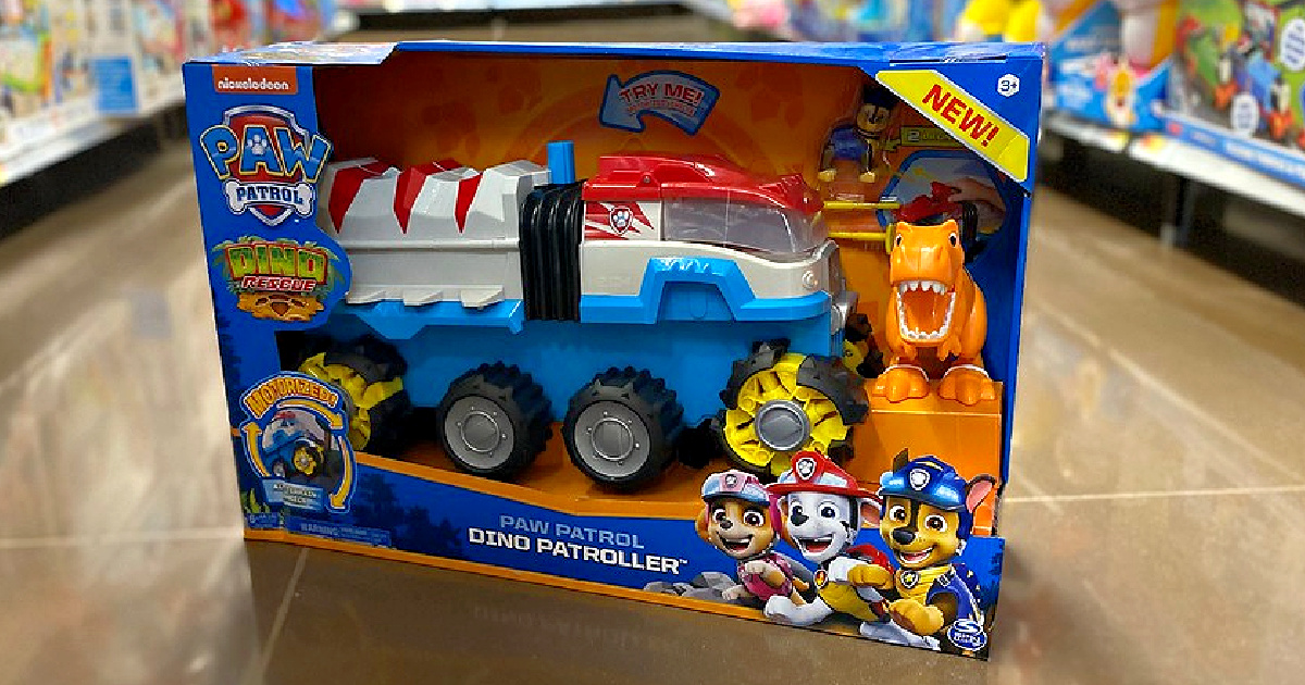 toy vehicle on floor in store aisle