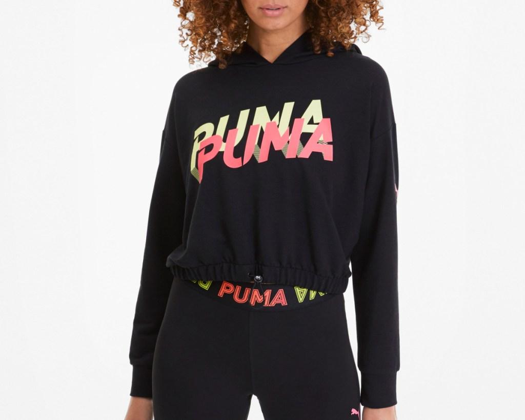 PUMA neon hoodie on woman