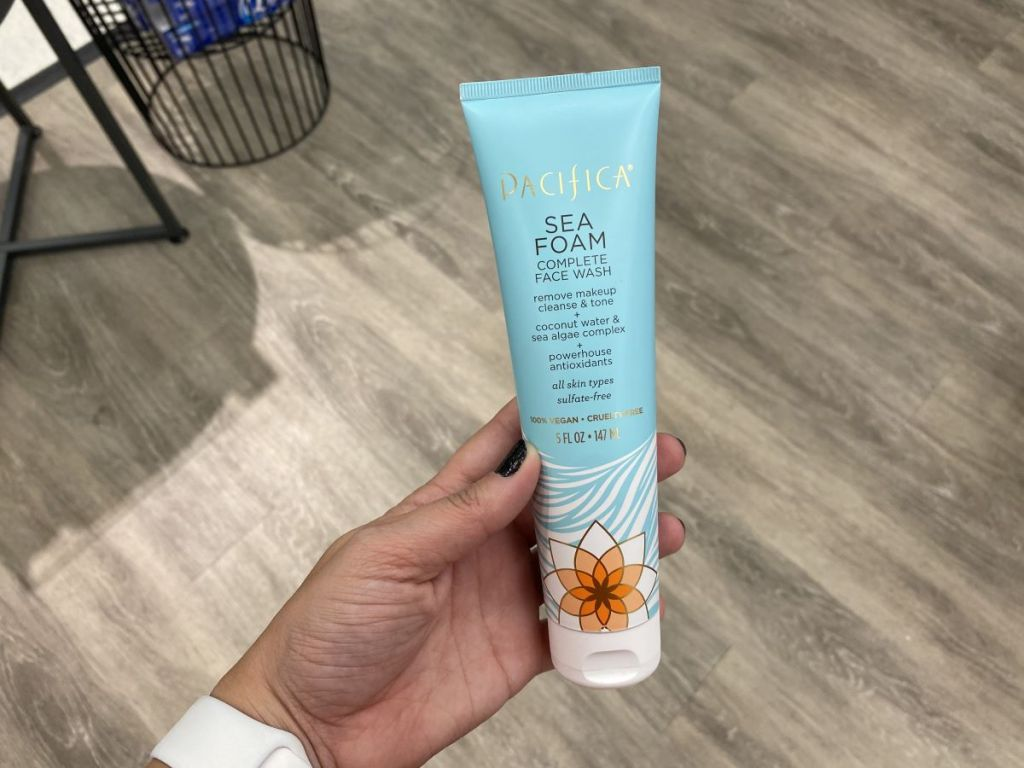 hand holding a Pacifica Face Wash