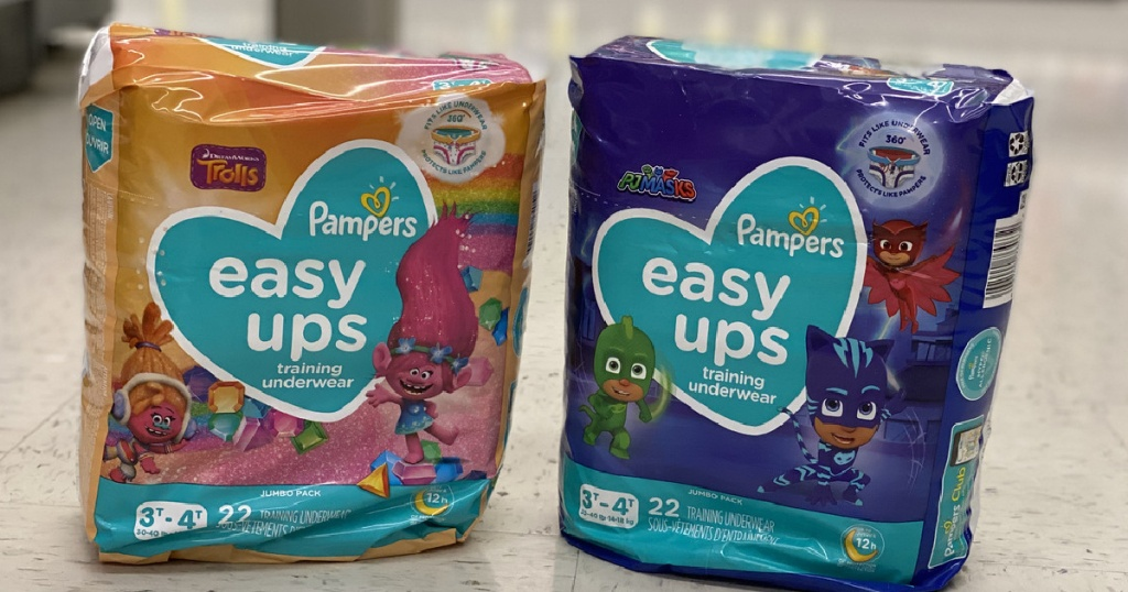 2 bags of Pampers brand training pants on store floor