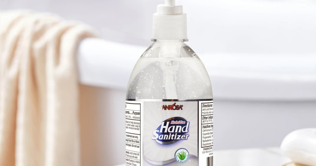 bottle of hand sanitizer with soap and towel in background