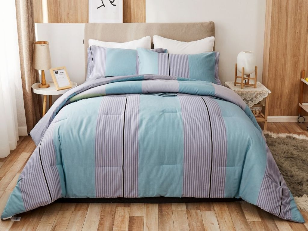 blue and purple Peach Leaf comforter on bed