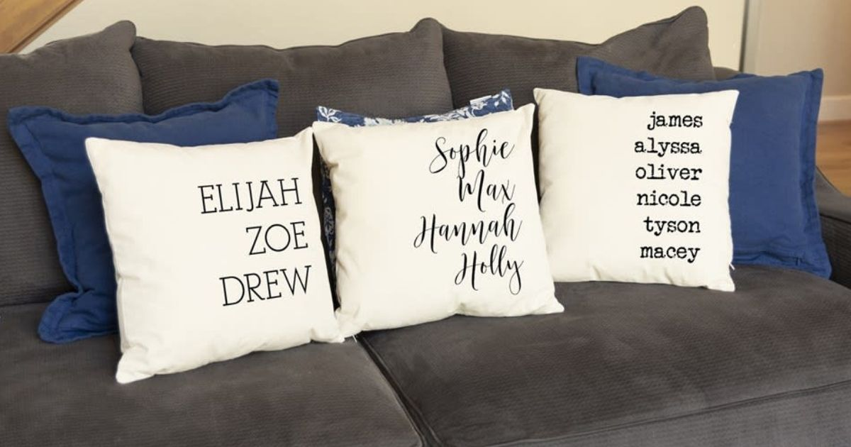 personalized pillowcase covers on throw pillows on a large gray sofa
