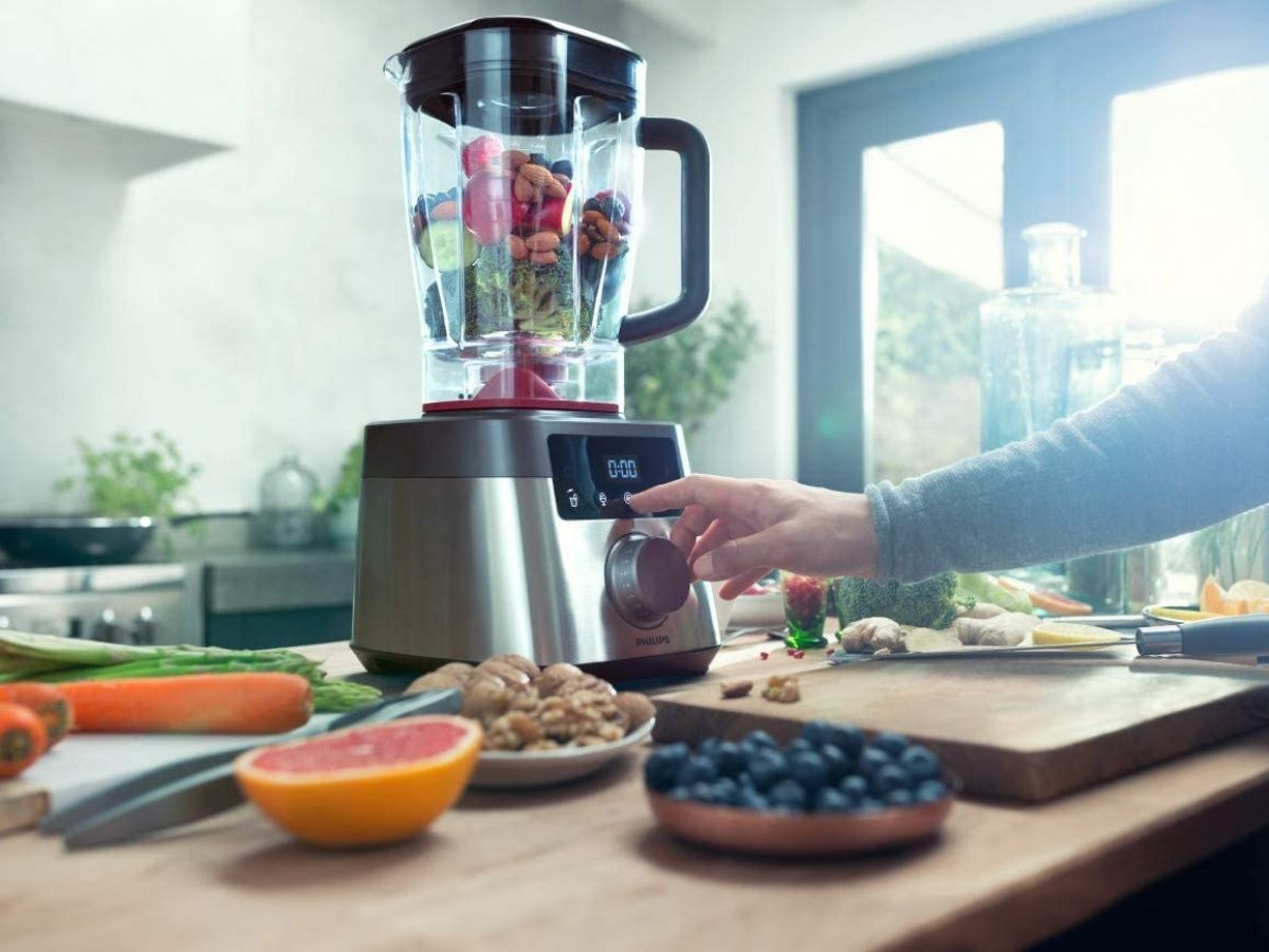 Philips blender in kitchen filled with veggies