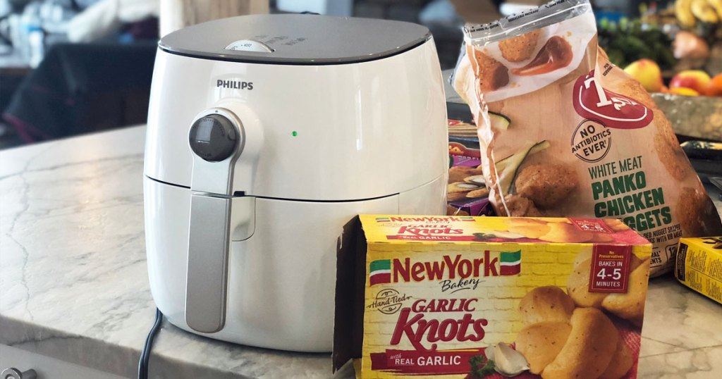 white Phillips air fryer on kitchen counter next to box of frozen garlic knots and chicken nuggets