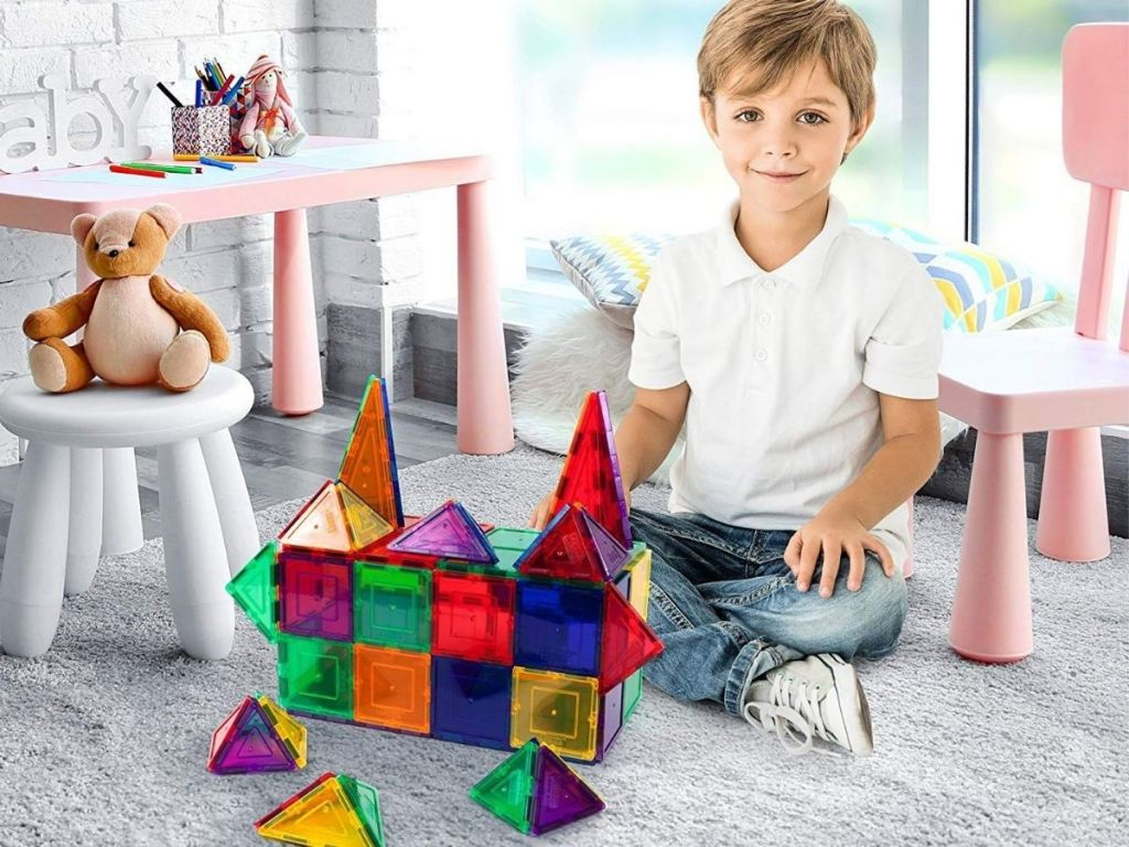 boy playing with Picasso Tiles in bedroom