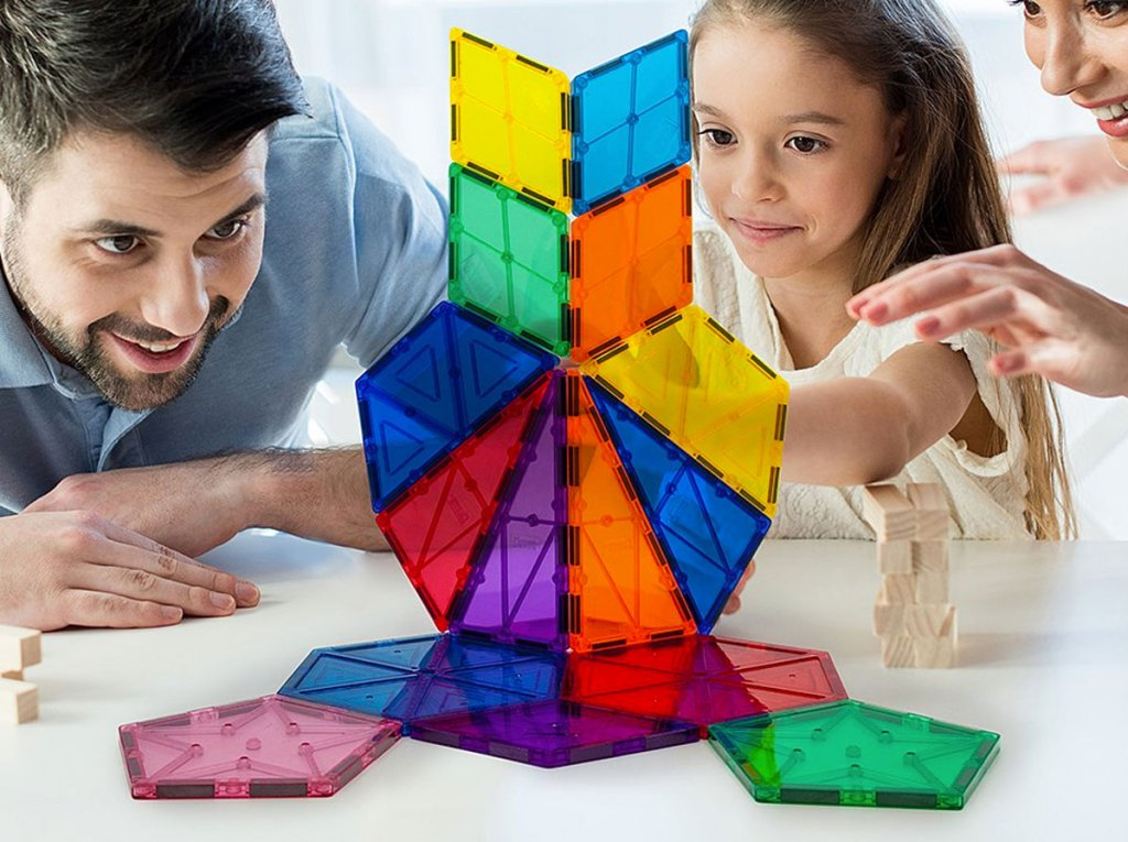 man and girl playing with 16-piece magnetic building block set