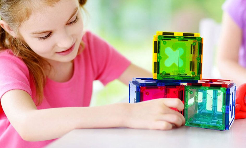 girl playing with magnetic numerical building block set