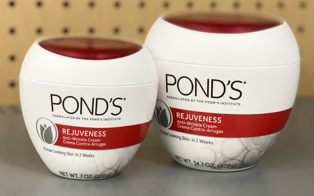 two white and red jars of Pond's Rejuveness Anti-Wrinkle Cream on grey shelf