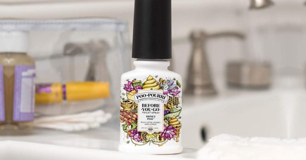 Honey Scent Poo-Pourri Spray on bathroom counter