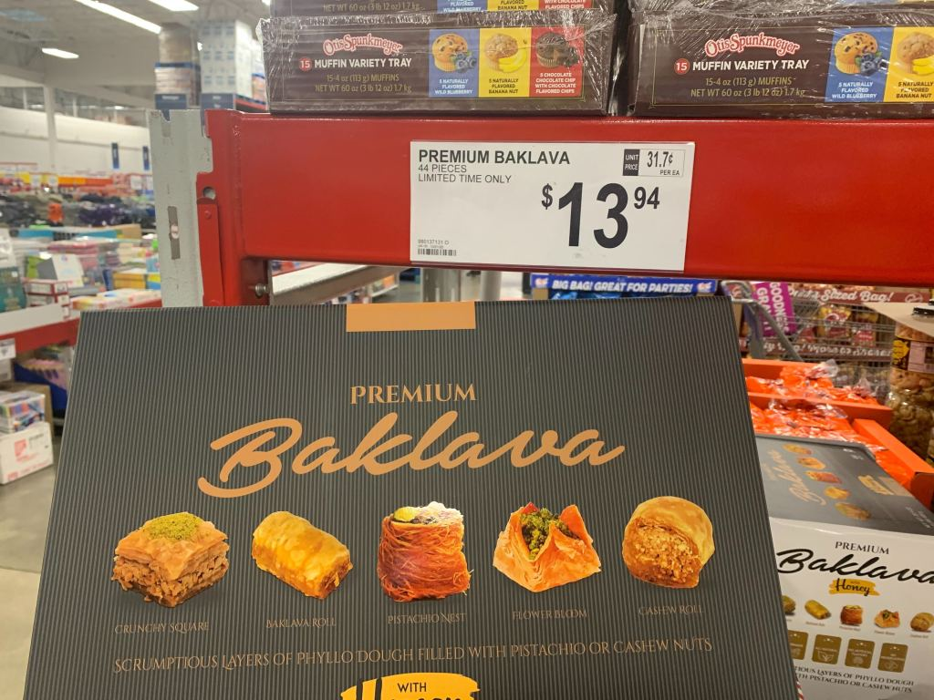 tray of Baklava next to a price tag at Sam's Club