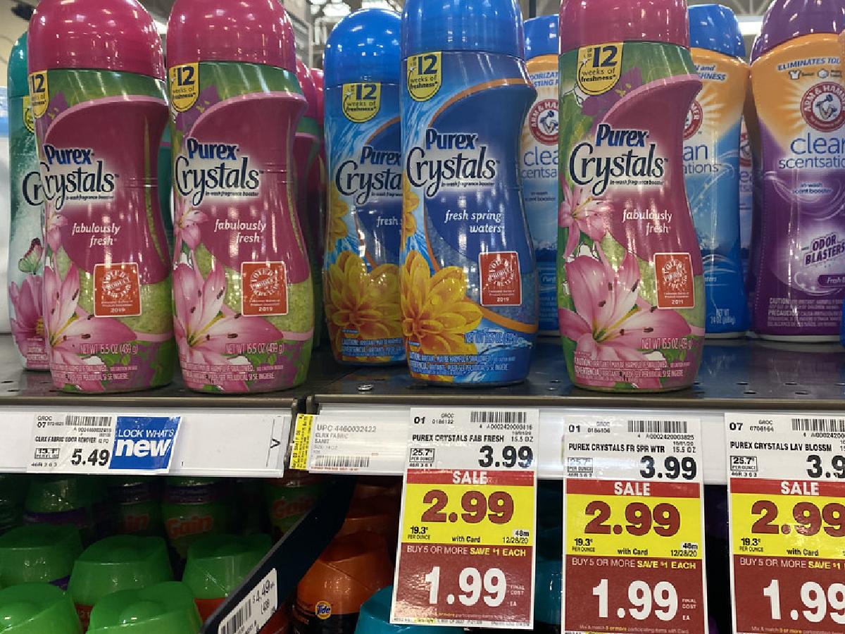 bottles of laundry freshener crystals on store shelf