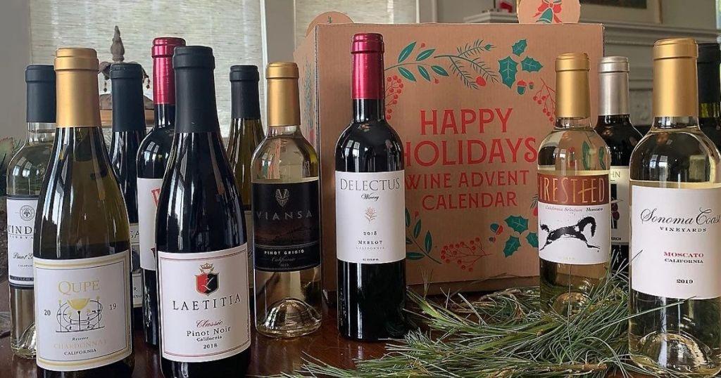 bottles of wine in front of wine calendar box
