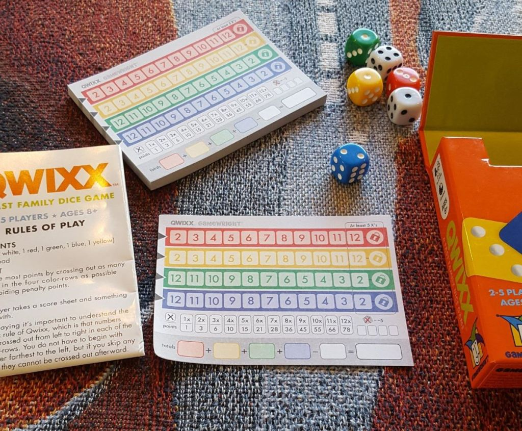 Qwixx game with scorecards and dice