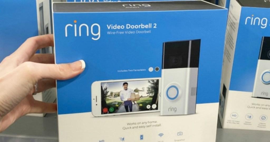 holding Ring Video Doorbell in box