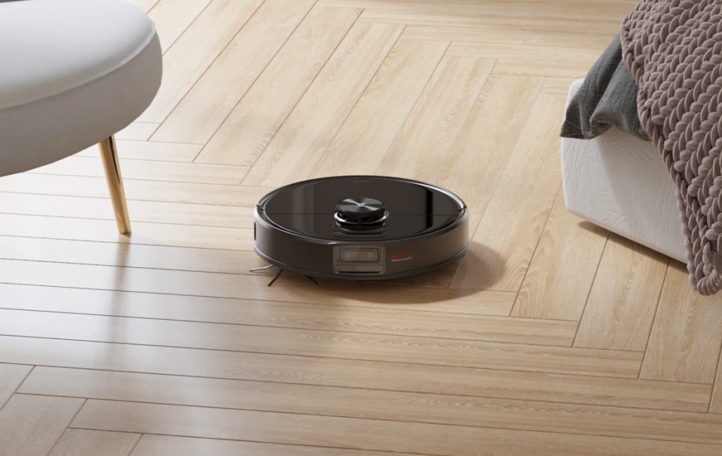 robot vacuum on bedroom floor