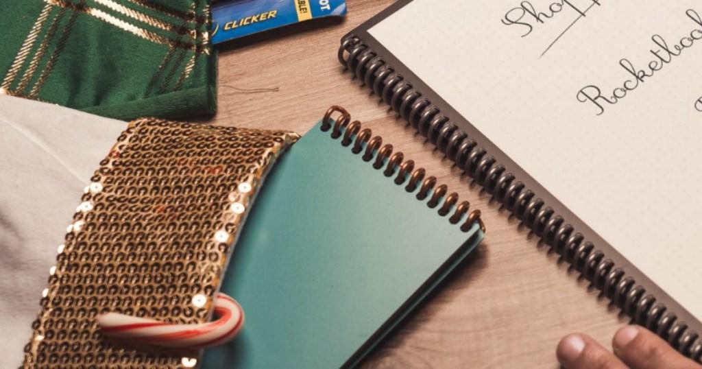 Greenish smart notebook peeking out of a Christmas stocking