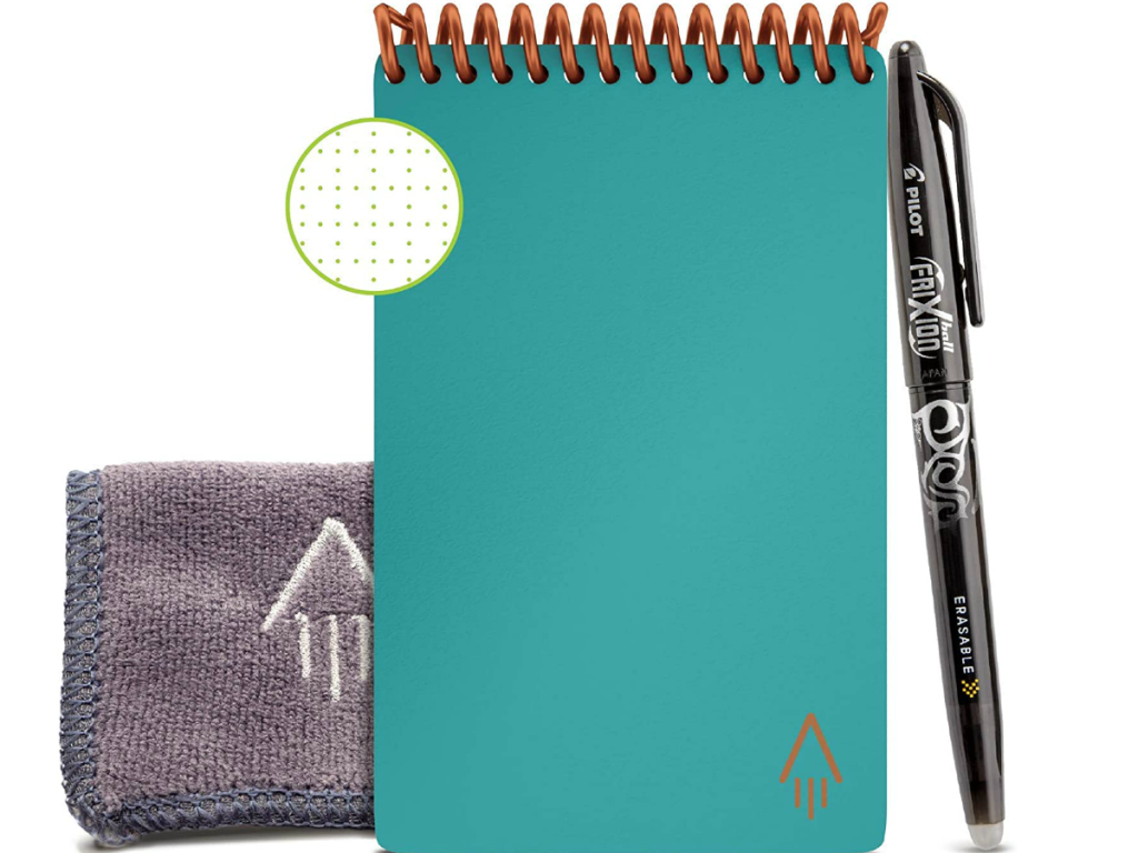 Light blue smart notebook next to cleaning pad and pen