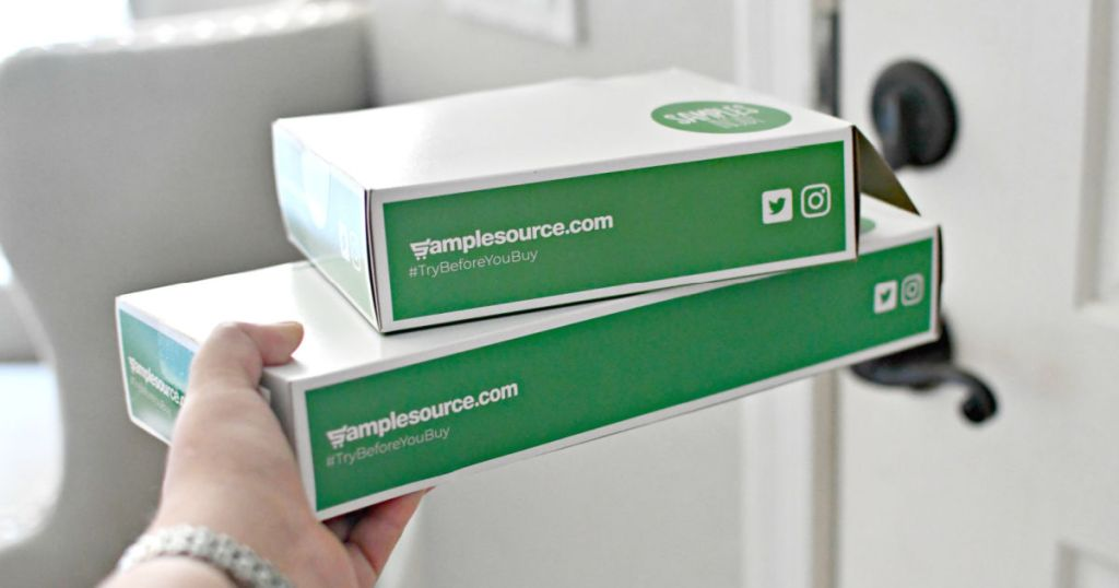 Person holding 2 SampleSource Boxes
