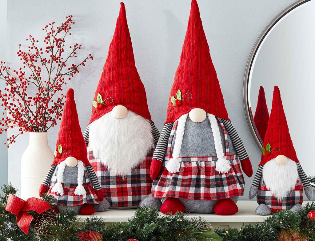 family of four christmas themed gnomes on a mantel