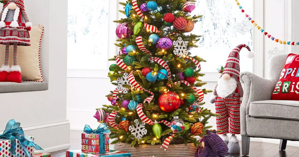 christmas tree decorated with ribbon and colorful ornaments in a living room with wrapped presents on the floor