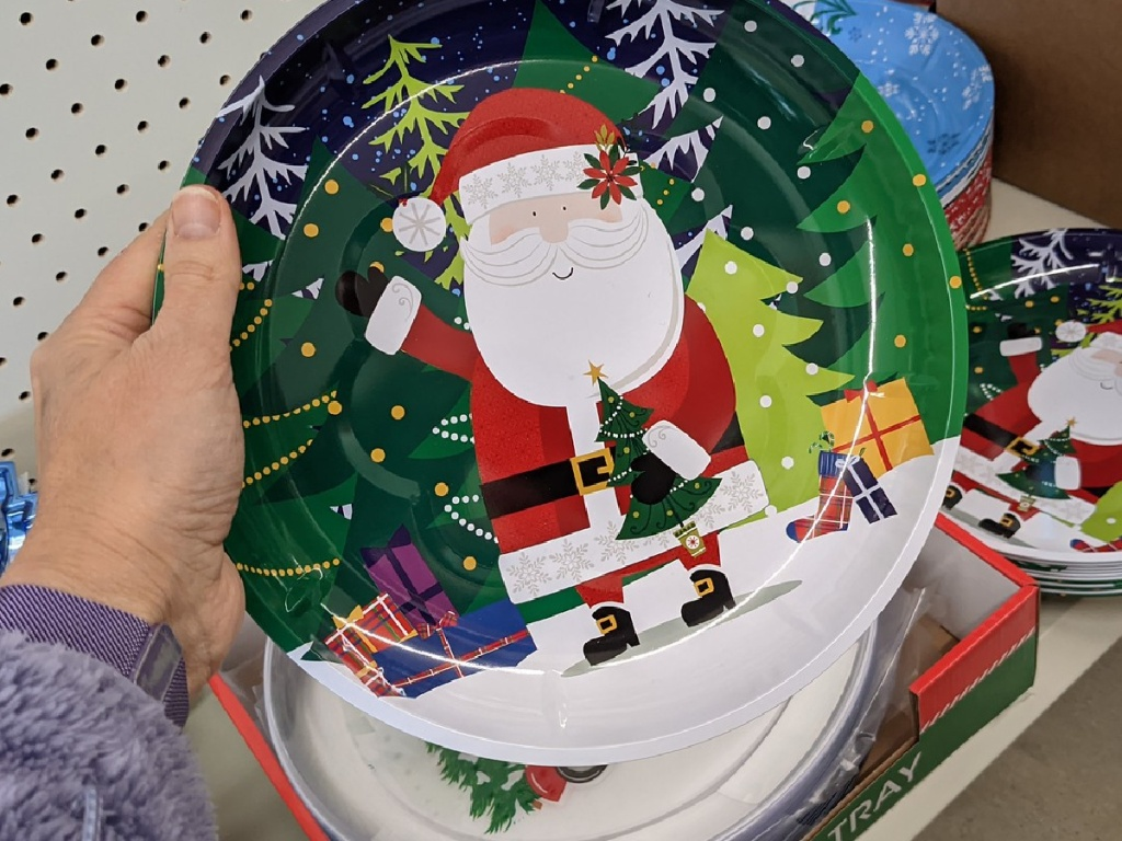 hand holding plate with Santa on it