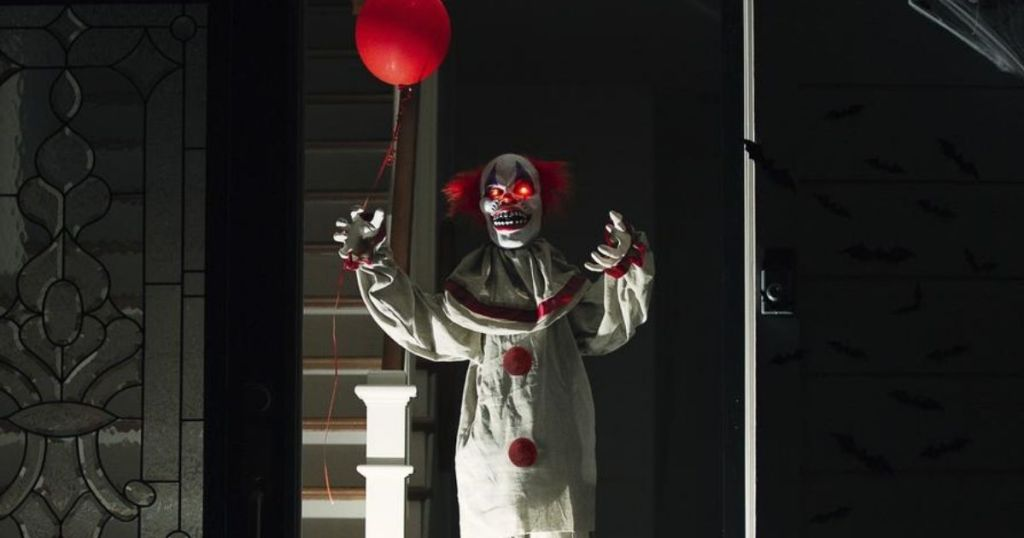 creepy clown holding a balloon