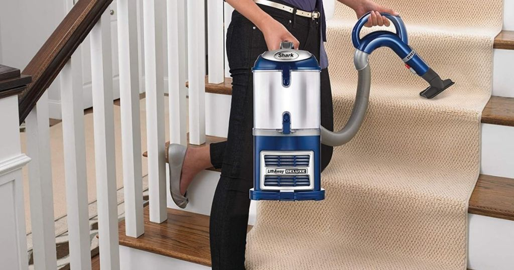 Shark Navigator lady vacuuming steps