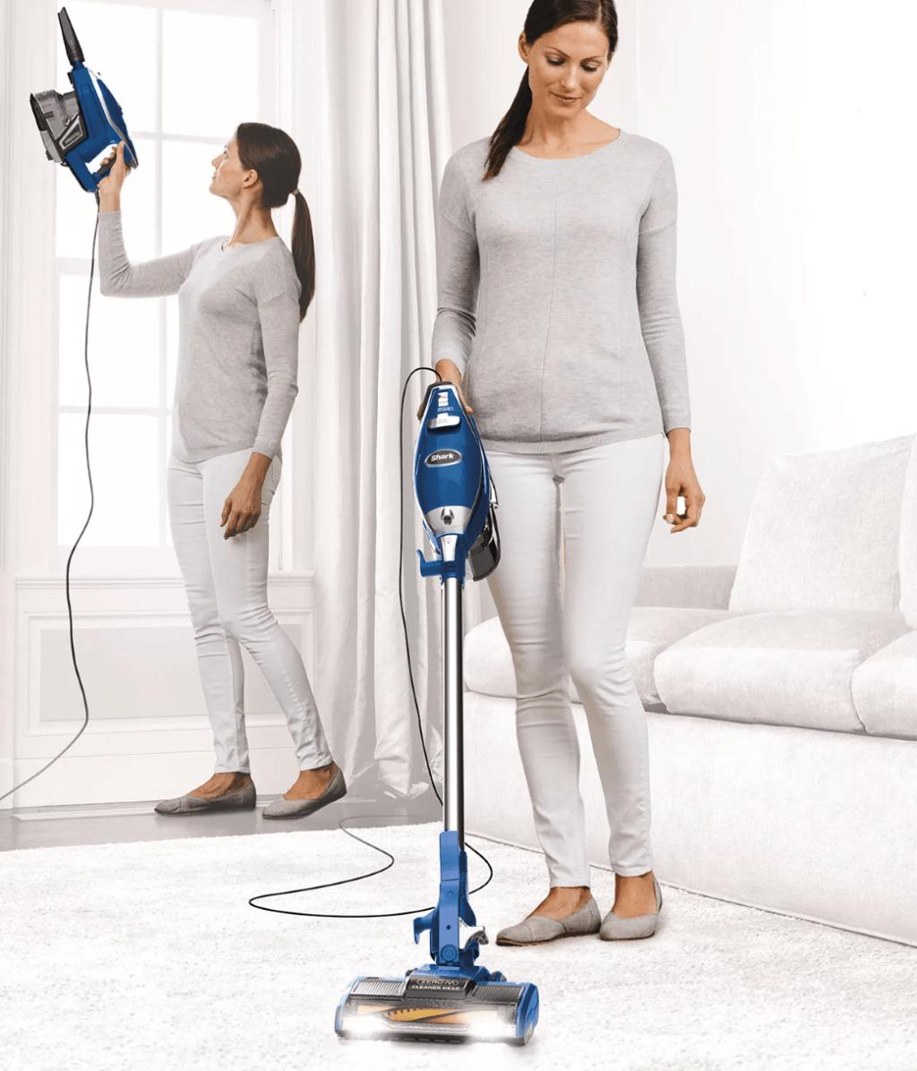 woman vacuuming a room