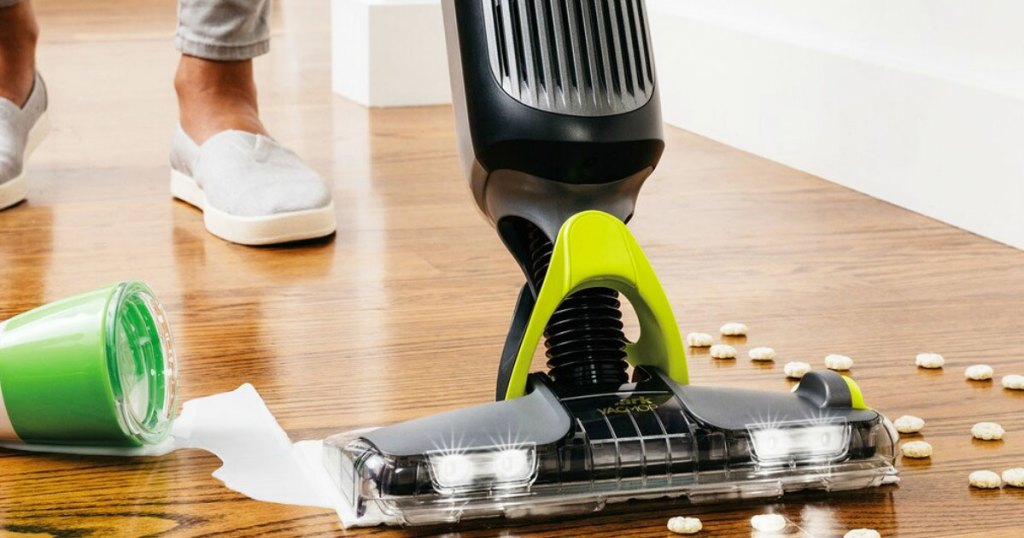black and grey shark vacmop cleaning up spilled milk and cereal on hardwood floor