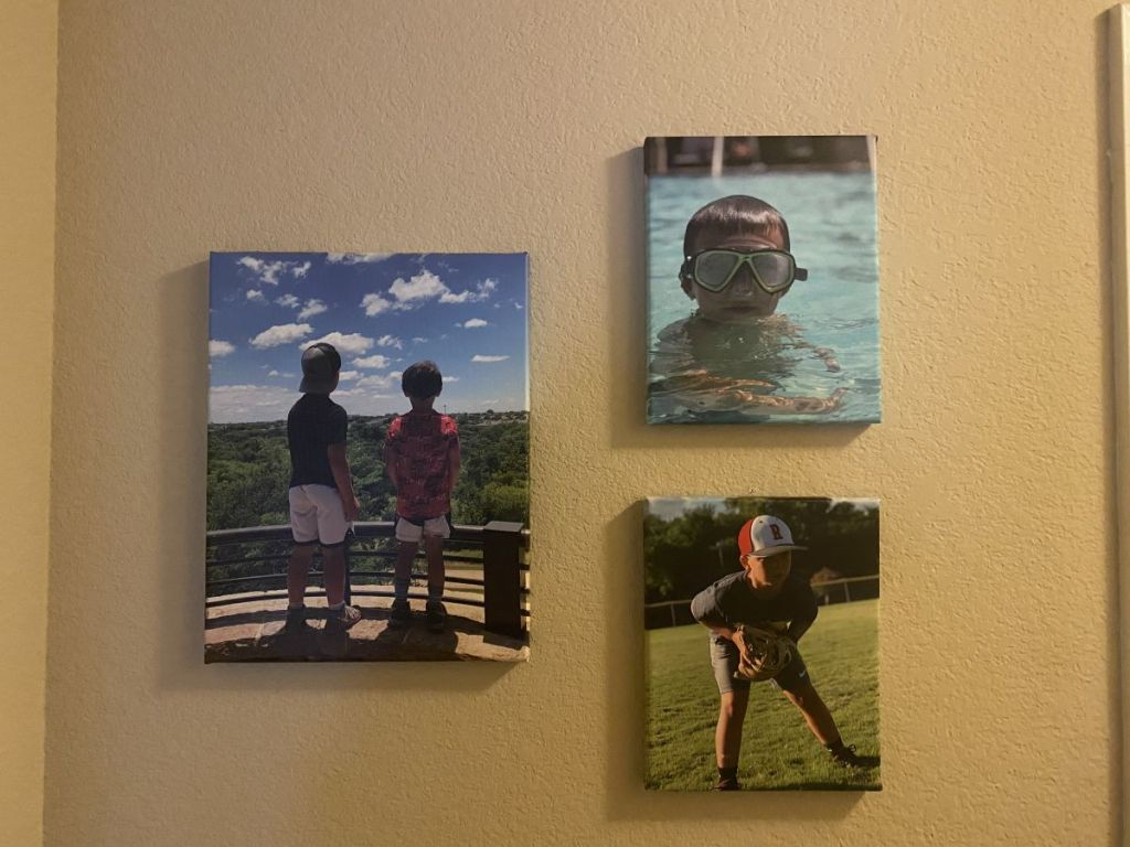wall with three canvas prints hanging