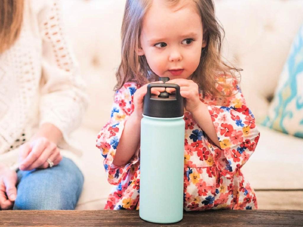 little girl drinking Simple Modern 22-Ounce Vacuum Insulated Bottle