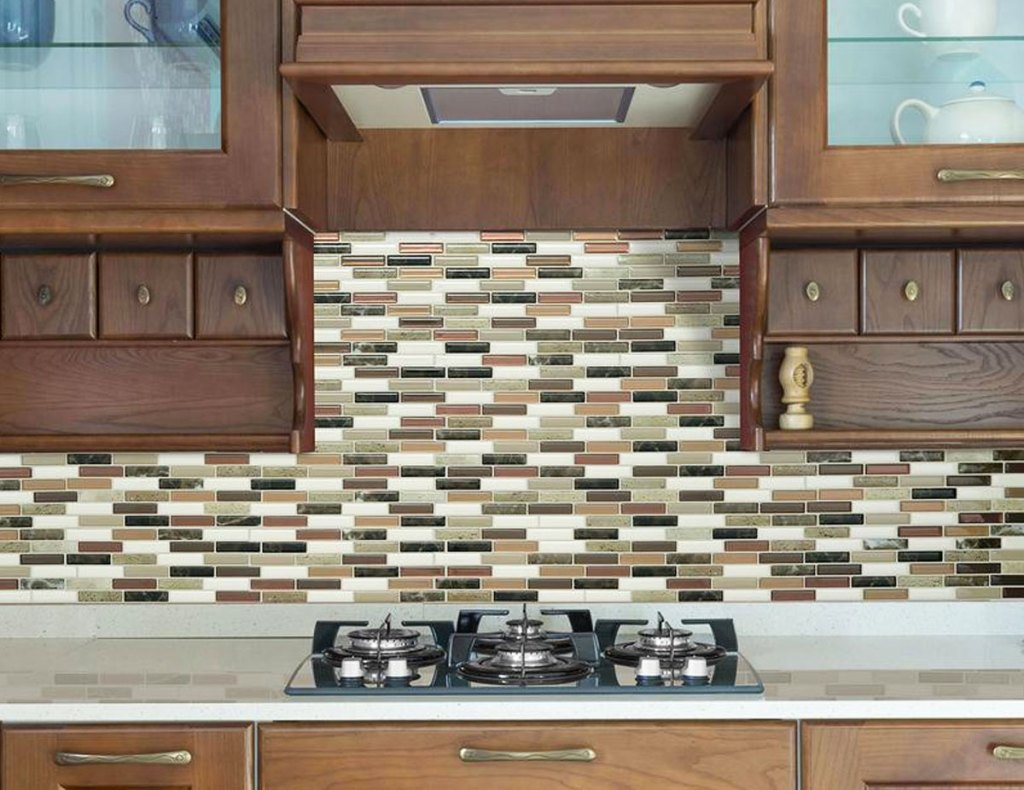 brown-tone peel and stick wall tiles on wall above stove