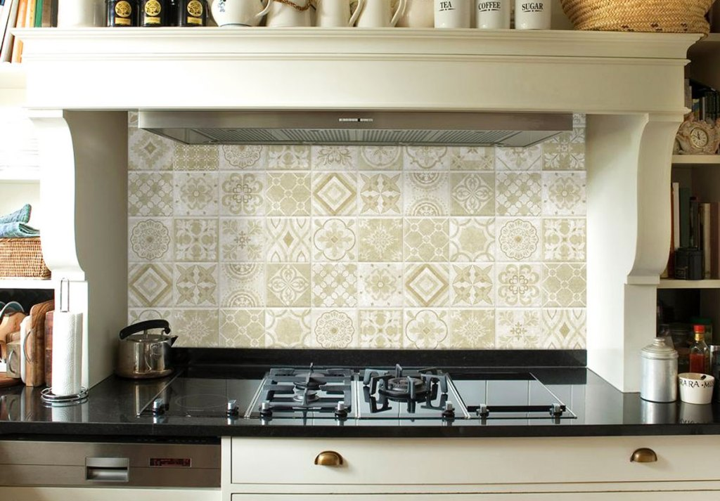 cream and white colored mosaic peel and stick tiles on wall above stove