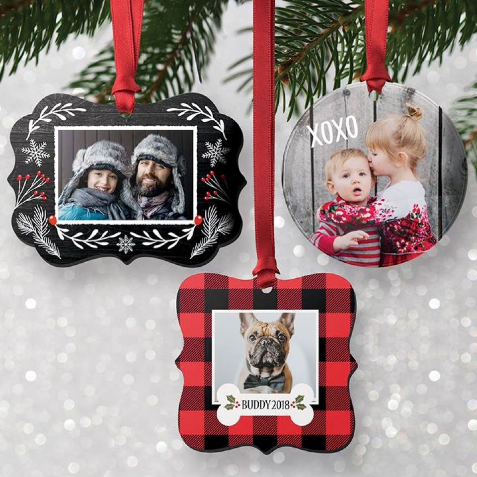 personalized ornaments hanging on a tree