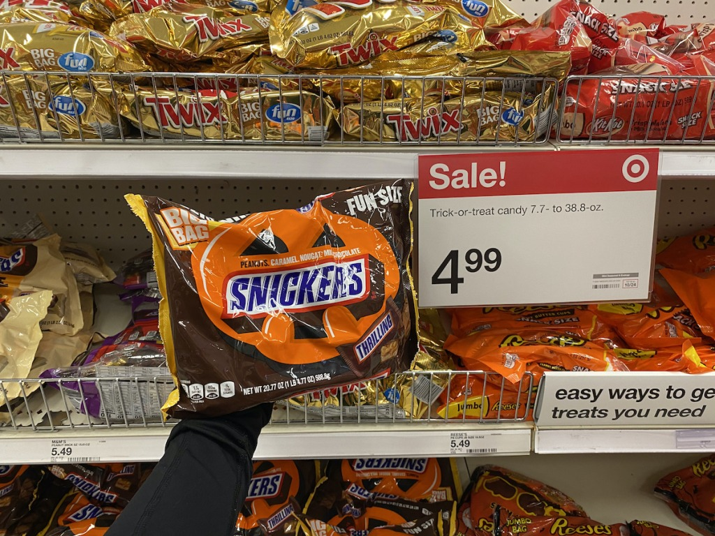 hand holding bag of Snickers halloween candy target