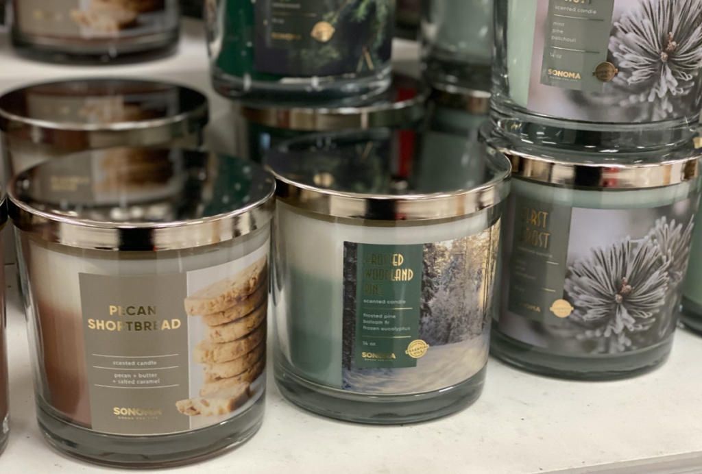various scented jar candles on table in store