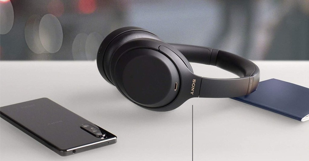 headphones on a table by a phone