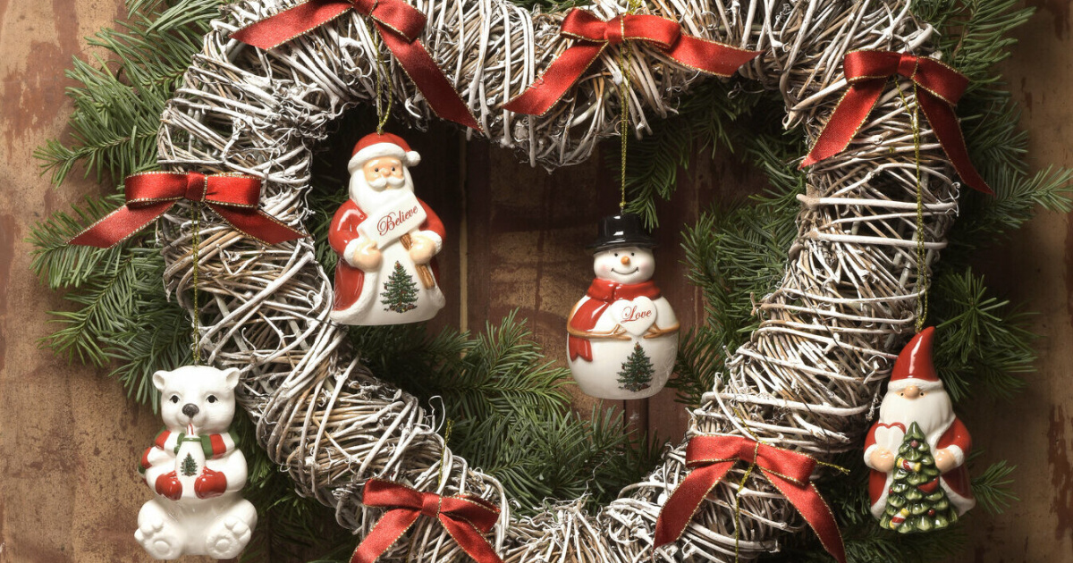 four christmas tree ornaments hanging on wreath on door