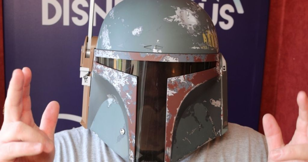 star wars boba fett helmet on person with hands up